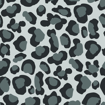 Seamless repeat pattern with hand drawn leopard cheetah wild cat spots in gray, charcoal and black