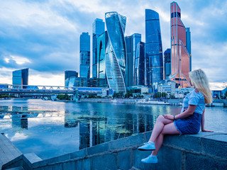 Russia. Skyscrapers. The center of the capital of Russia. Moscow-city. Tall building. Modern architecture. The girl admires the view of Moscow. River Moscow. Urbanistics.