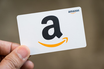 Hand hold an Amazon gift card isolated