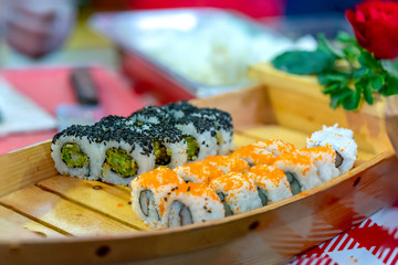 Sushi roll with fish, shrimps, eggs or vegetables is a popular Japanese food