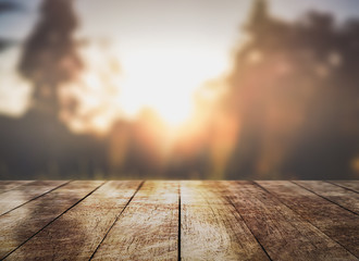 Empty wooden table top with lights bokeh on nature blur background