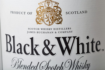 Black and White Scotch Whisky bottle closeup in Kyiv, Ukraine.