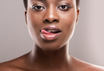 Fototapete - Closeup portrait of beautiful african girl licking her lips seductively