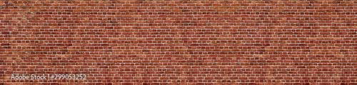 Fotobehang Old red brick wall background, wide panorama of masonry