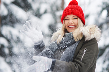 Happy woman having fun over winter