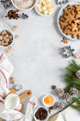 Christmas or Xmas baking culinary background. Ingredients for cooking on kitchen table. New Year or Noel holiday festive decorations, copy space