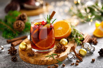 Christmas mulled wine. Traditional Xmas festive drink with decorations and fir tree