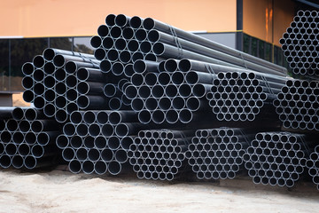 Black steel pipe bundles at the construction site