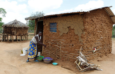 Mwende Kilonzi, who lost a child after a snake bite, is seen outside her house at Nguni village in Mwingi,