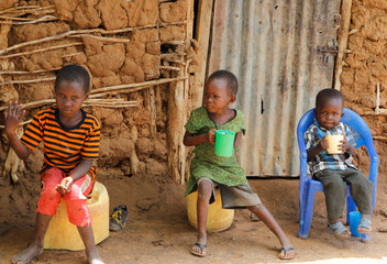 Children are seen outside their house during a snakebite sensitisation exercise at Malalani village in Mwingi