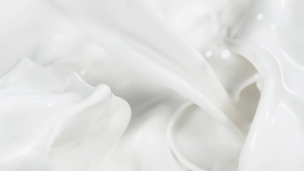 Macro shot of pouring cream in detail