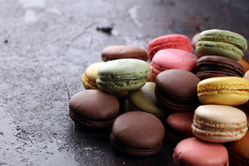 Printed kitchen splashbacks Macarons Sweet and colourful french macaroons or macaron on dark black background, Dessert.
