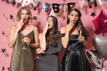 Image of sleepy party girls drinking champagne while celebrating birthday