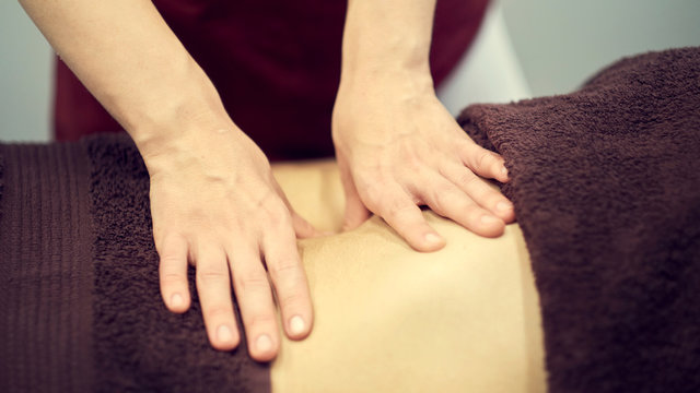 Treatment massage for weight loss in spa salon. Massage back for woman. Spa massage for correction figure.