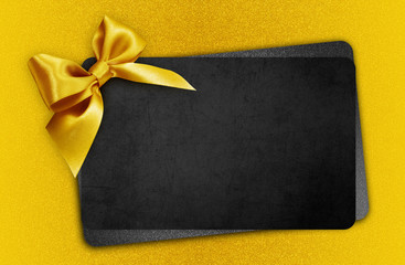 Fotomurales - black gift card with golden ribbon bow, black friday concept