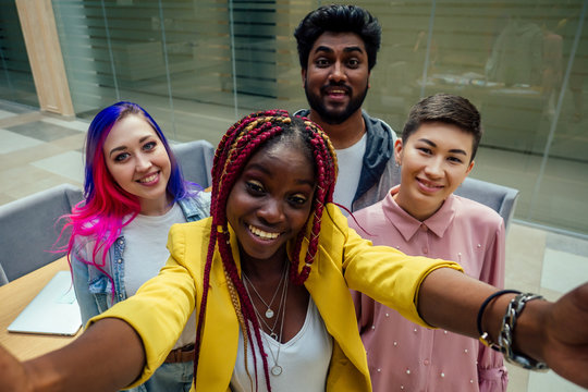 multiracial business group working taking selfie portrait on camera smartphone at modern office