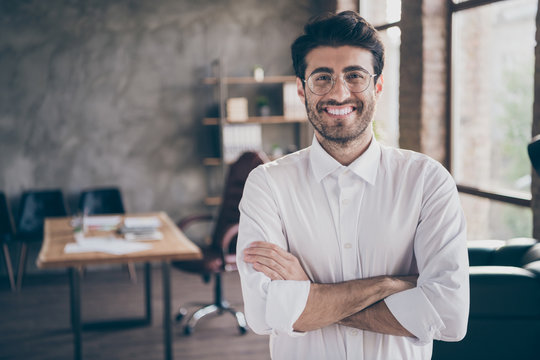 Portrait of positive cheerful middle eastern entrepreneur cross his hands feel real successful start-up owner in enterprise office