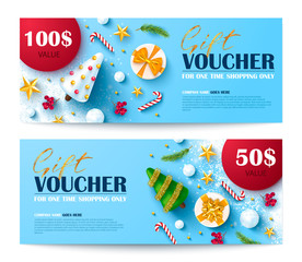 Gift voucher for Christmas and New Year sale.Vector illustration with fir twigs,candy,snowballs,gift boxes,Christmas balls and confetti.Design of discount coupon usable for invitations or tickets.