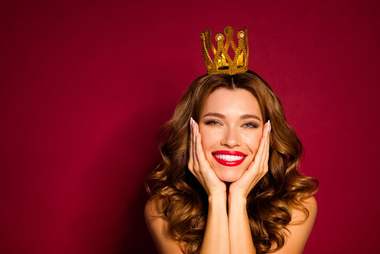 Photo of model lady red pomade nude shoulders golden crown on head arms cheekbones enjoy celebrity social status isolated burgundy color background