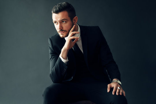 Elegant young man portrait on black background