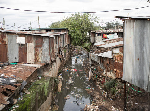 Polluted water flows through the Kibera slum in Africa.