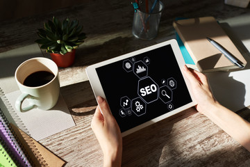 SEO - Search engine optimization. DIgital marketing concept on screen.