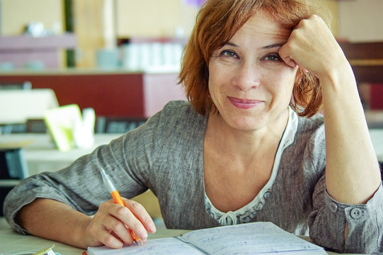Happy mature woman with notebook portrait