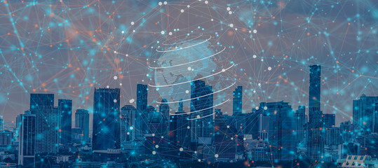 Business and communication concept.5G network digital hologram and internet of things on city background.5G network wireless systems.