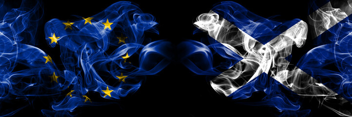 Eu, European union vs Scotland, Scottish smoke flags placed side by side. Thick colored silky smokes abstract flags