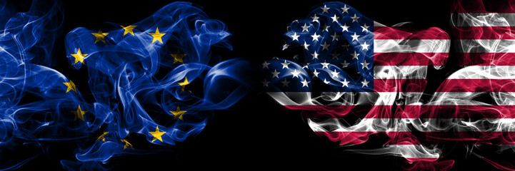 Eu, European union vs United States of America, American, USA smoke flags placed side by side. Thick colored silky smokes abstract flags