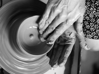 Making Ceramic Molds: Hands molding pottery. Mugs made of clay