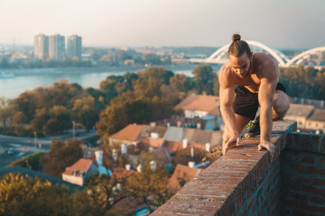 Man standing on a wall. Free running parkour - Stock photo