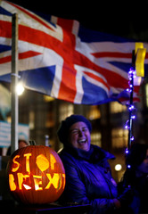 """A pumpkin with """"Stop Brexit"""" engraving sits outside the Houses of Parliament in London"""