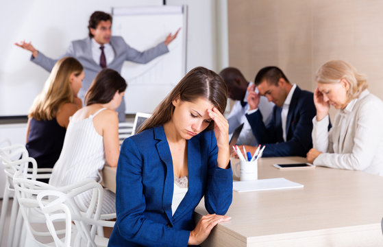 Upset business woman on meeting