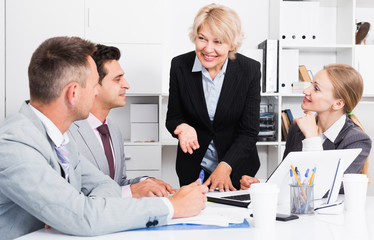 Businesswoman working with colleagues in office
