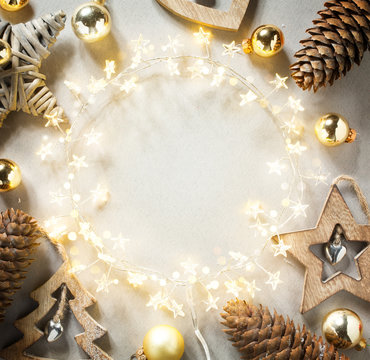 Christmas Tree Light garland and Christmas Decoration on White Background; Merry Christmas and happy New Year greeting Card or holiday banner