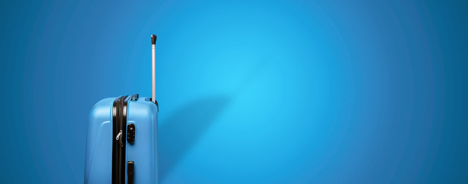 blue travel suitcase over blue background, panoramic mock up image