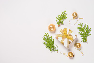 Foto op Plexiglas Spa Christmas flat lay background with golden decorations on white.