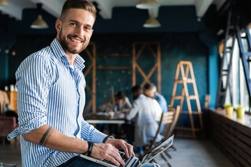 Man Working At Laptop In Contemporary Office Wall mural