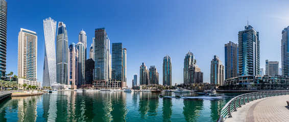 Printed roller blinds Dubai Dubai Marina skyline during the day of buildings and water with boats