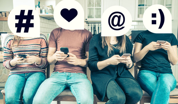 Group of friends using smartphones to communicate in social media. Concept of a generation of millennials who are online all the time. Warm hipster filter.