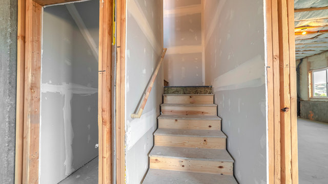 Panorama frame Under construction wooden stairs in a basement