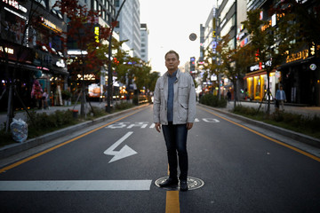 Park Chol-hee, whose brother was killed in a crane collapse in 2017 at a Samsung shipyard, poses for photographs in Seoul