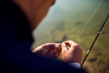 A fisherman prepare fishing tackle