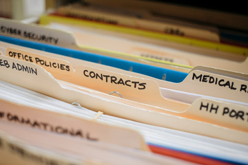 medical record charts on shelve sorted alphabetically