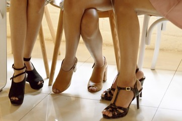 Beautiful picture of three females legs wearing high heels