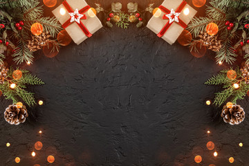 Fototapete - Christmas gift boxes on holiday background with Fir branches, pine cones. Xmas and Happy New Year theme, bokeh, sparking, glowing. Flat lay, top view, space for text