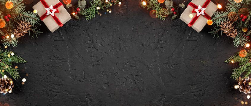 Christmas gift boxes on holiday background with Fir branches, pine cones. Xmas and Happy New Year theme, bokeh, sparking, glowing. Flat lay, top view, space for text