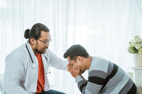sad patient consultation with doctor try to comfort him of the bad news
