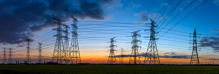 High voltage electricity tower sky sunset landscape,industrial background.